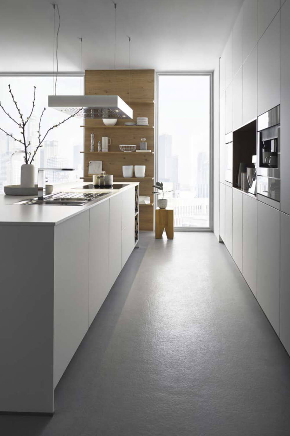 White kitchen with tall cupboards and island (1)
