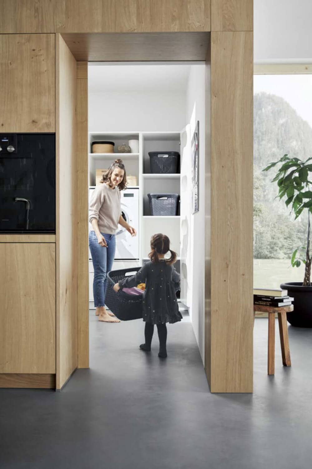 Mother and child in utility room