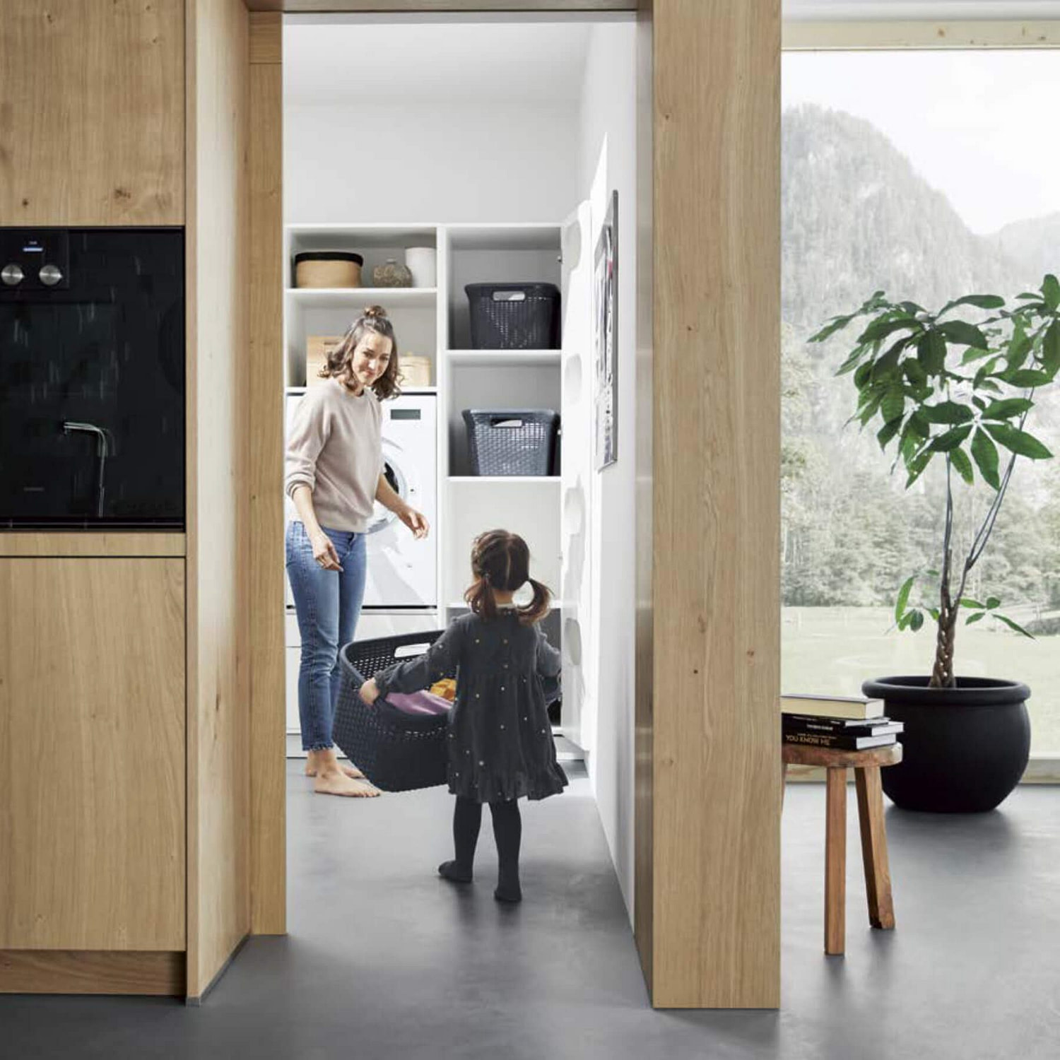 Girl and mother in utility room
