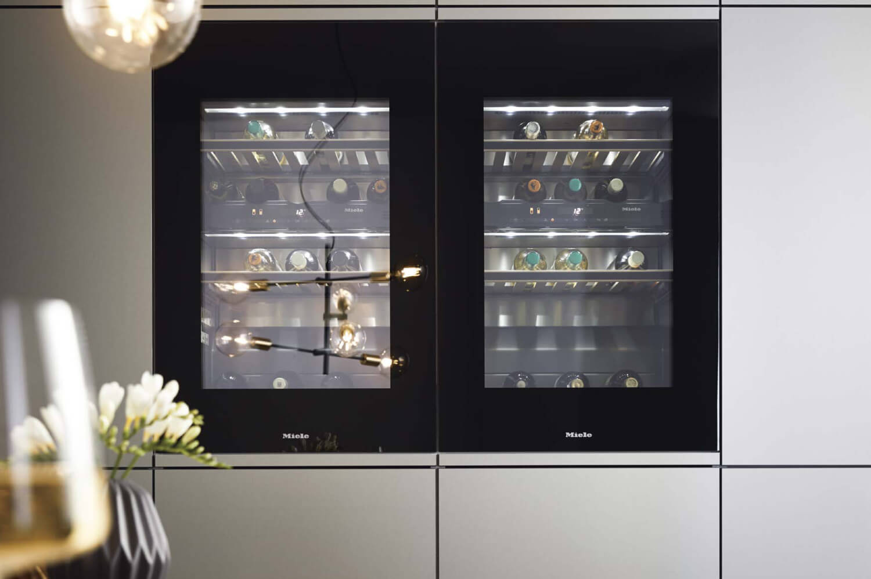 Miele wine fridges in handleless cupboards