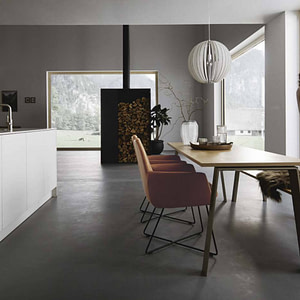Matt white open plan kitchen with dining table