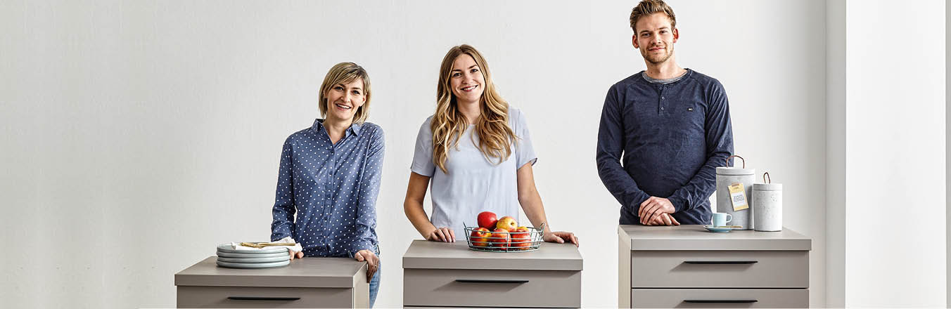 People standing at different height worktops