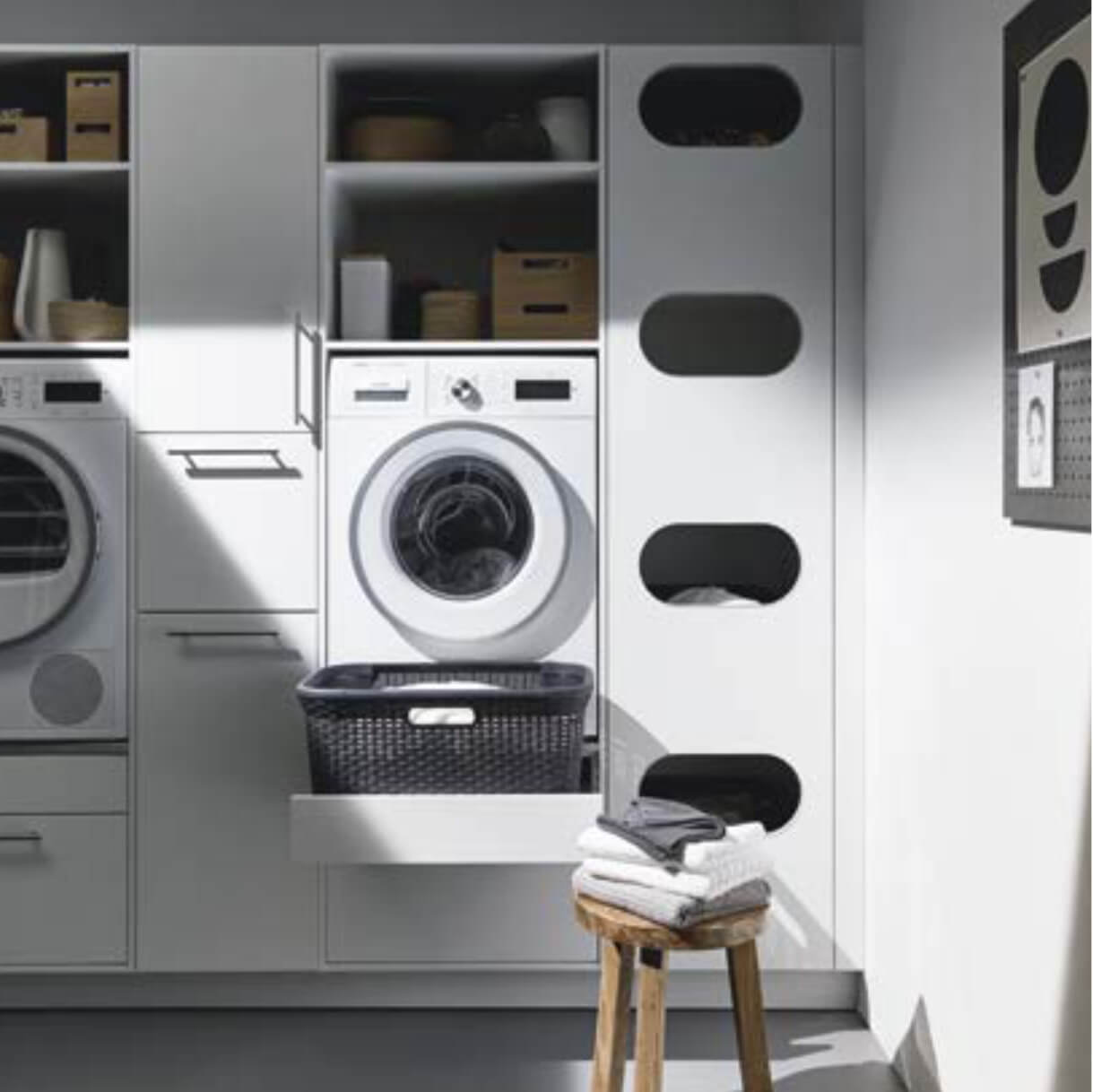 Washer and dryer in tall utility cupboards
