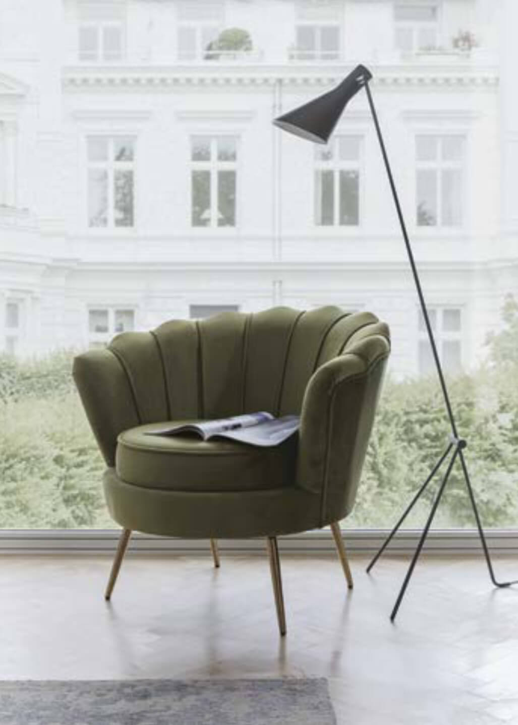 Green armchair with lamp