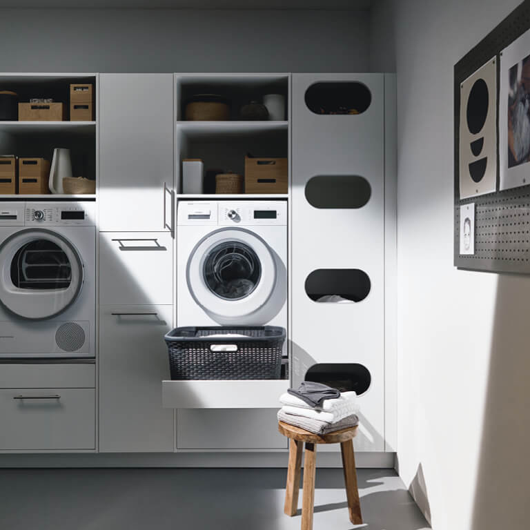 Laundry cupboards, washing machine and dryer