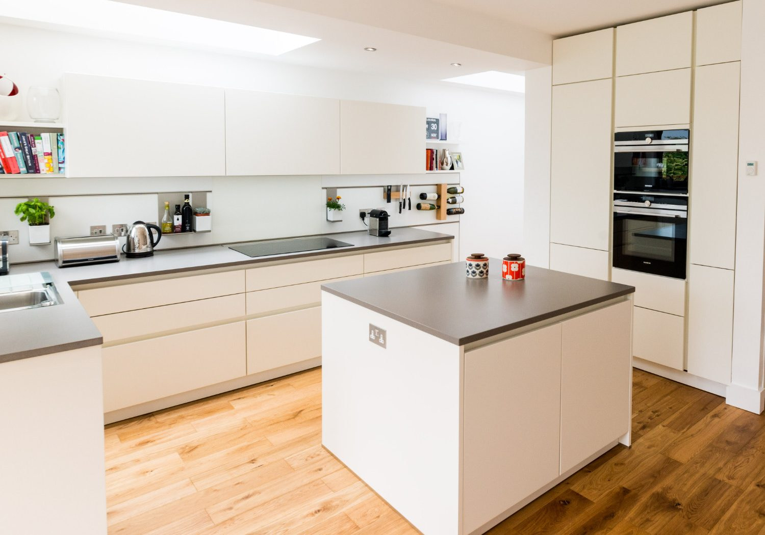 White handleless kitchen with tall cupboards
