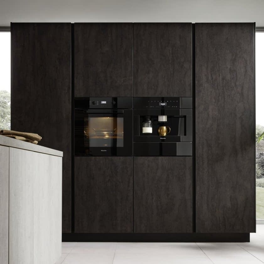 Tall cupboards with appliances and fridge
