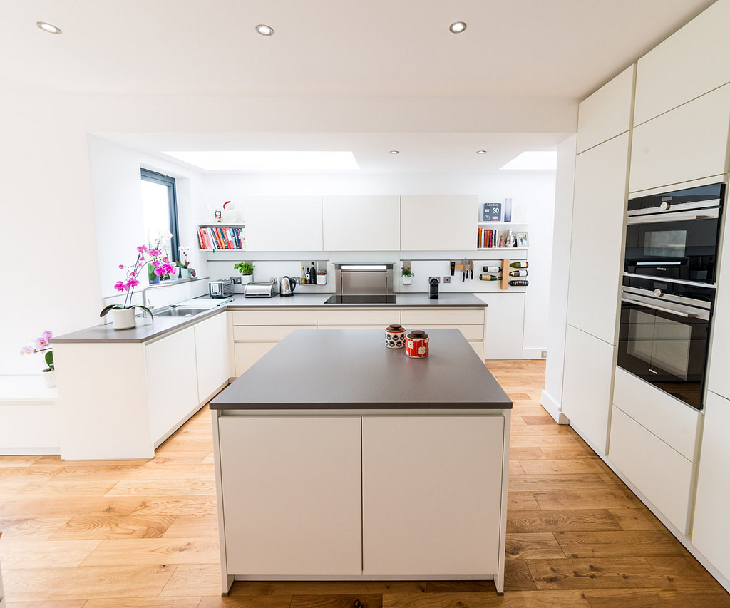 Matt white handleless kitchen island